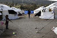 Pictured: A woman and child at the Schisto camp site Friday 26 February 2016<br />