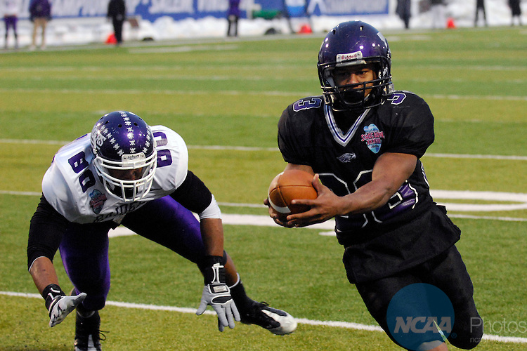 19 DEC 2009: Levell Coppage (33) of the University of Wisconsin-Whitewater scores one of his three touchdowns against Mount Union College during the Division III Men's Football Championship held at Salem Stadium in Salem, VA.  Wisconsin-Whitewater defeated Mount Union 38-28 for their second national title.  Coppage was named the games MVP. Andres Alonso/NCAA Photos