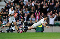 Danny Cipriani of England dives over to score the final try as he is awarded Man of the Match during the match between England and Barbarians at Twickenham Stadium on Sunday 31st May 2015 (Photo by Rob Munro)
