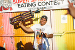 Brooklyn, NY - August 24, 2014: Competitive Eater Wayney Wonder celebrating his win at the &quot;Super Spicy Kimchi Eating Contest&quot; hosted by Mama O's Kimchi at Crown Victoria in Williamsburg. <br /> <br /> CREDIT: Clay Williams.<br /> <br /> &copy; Clay Williams / claywilliamsphoto.com