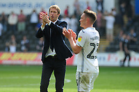 Graham Potter Manager of Swansea City applauds the fans at the final whistle during the Sky Bet Championship match between Swansea City and Rotherham United at the Liberty Stadium in Swansea, Wales, UK.  Friday 19 April 2019