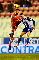 Blackpool's Curtis Tilt competes with Wigan Athletic's Nick Powell<br /> <br /> Photographer Richard Martin-Roberts/CameraSport<br /> <br /> The EFL Sky Bet League One - Wigan Athletic v Blackpool - Tuesday 13th February 2018 - DW Stadium - Wigan<br /> <br /> World Copyright &not;&copy; 2018 CameraSport. All rights reserved. 43 Linden Ave. Countesthorpe. Leicester. England. LE8 5PG - Tel: +44 (0) 116 277 4147 - admin@camerasport.com - www.camerasport.com