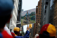 A banner with the image of Venezuela president Maduro and Cuba's former President Fidel Castro while Venezuela's government opposition members take part in a rally against president Maduro and his government in front of Venezuela's consulate in New York,  04/19/2015. Eduardo MunozAlvarez/VIEWpress
