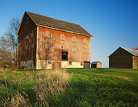 Lee County, IL<br /> Weathered red barn with shuttered windows