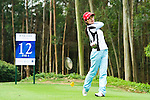 Cuixia Chen of China tees off during the 2011 Faldo Series Asia Grand Final on the Faldo Course at Mission Hills Golf Club in Shenzhen, China. Photo by Raf Sanchez / Faldo Series