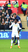 17th March 2018, Liberty Stadium, Swansea, Wales; FA Cup football, quarter-final, Swansea City versus Tottenham Hotspur; Jan Vertonghen of Tottenham Hotspur gets up over Nathan Dyer of Swansea City to win the header