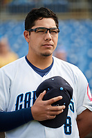Lake County Captains first baseman Ulysses Cantu (8) stands for the national anthem before the first game of a doubleheader against the South Bend Cubs on May 16, 2018 at Classic Park in Eastlake, Ohio.  South Bend defeated Lake County 6-4 in twelve innings.  (Mike Janes/Four Seam Images)