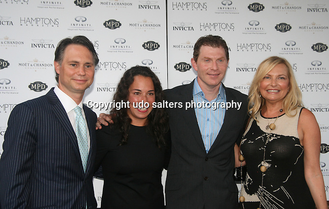 Niche Media CEO & Founder Jason Binn, Hamptons Magazine Editor-In-Chief Samantha Yanks, Bobby Flay and Publisher of Hamptons Magazine Debra Halpert attend Bobby Flay Celebrates with Hamptons Magazine-Invicta Watch & Infiniti at MPD, New York