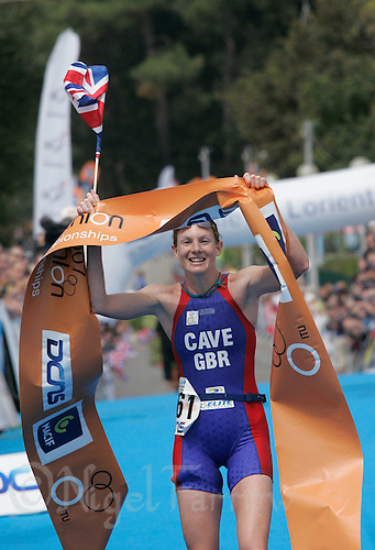 15 JUL 2007 - LORIENT, FRA - Leanda Cave celebrates winning the World Elite Womens Long Distance Triathlon Championships. (PHOTO (C) NIGEL FARROW)