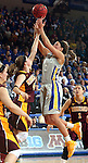 BROOKINGS, SD - MARCH 27:  Kerri Young #10 from South Dakota State University shoots against Joanna Hedstrom #22 from the University of Minnesota in the first half of their sweet sixteen gameThursday night at Frost Arena in Brookings. (Photo by Dave Eggen/Inertia)