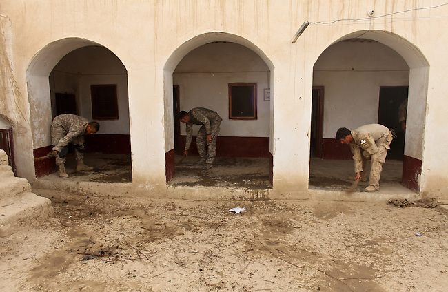 U.S. troops with Company B, 2nd Battalion, 508th Parachute Infantry Regiment and a Canadian soldier sweep up in a compound they have taken over for a new outpost in the village of Deh-e-Chowkay, in the Arghandab valley near Kandahar, Afghanistan. May 23, 2010. DREW BROWN/STARS AND STRIPES