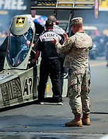 Jul 29, 2018; Sonoma, CA, USA; A US Army soldier cheers for NHRA top fuel driver Tony Schumacher during the Sonoma Nationals at Sonoma Raceway. Mandatory Credit: Mark J. Rebilas-USA TODAY Sports