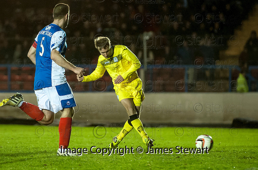Queen of the South's Iain Russell scores their second goal.