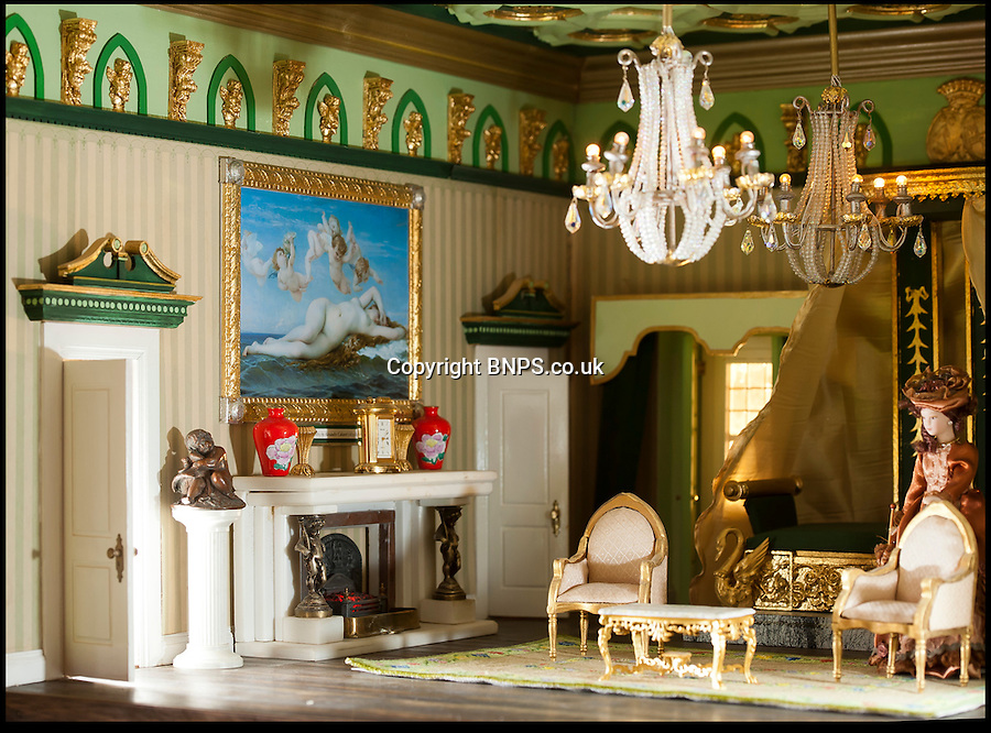 """BNPS.co.uk (01202) 558833<br /> Picture: Peter Willows<br /> <br /> Georgian Manor complete with stunning rooms...<br /> <br /> Every little girls Xmas wish...A meticulously crafted dolls house that has taken Len Martin from Dorset 26 years to complete in his garden shed.<br /> <br /> Len is now selling his masterpiece in time for Xmas..but any bidders for 'Langdon Hall' will need deep pockets to come up with the £10,000 asking price.<br /> <br /> Leonard Martin, 68, was inspired to make the ornate house after he doodled a picture of his 'perfect home' on a scrap of paper while he was bored at work in 1987.<br /> <br /> He has worked on the miniature property up to five hours a day since then to build the extravagant home and make his dreams a reality.<br /> <br /> The 6ft 2ins long and 3ft 6ins tall building has two bedrooms, two bathrooms, a kitchen, sitting room, dining room, and hallway all filled with tiny furniture.<br /> <br /> Leonard has spared no expense on the detailed Georgian manor and has spent more than 6,000 pounds building and filling the rooms.<br /> <br /> He has splashed out on detailed finishes and period furnishings including a Swarvoski crystal chandelier, hand stitched carpets, and real marble flooring.<br /> <br /> There are miniature beds, settees, cupboards, baths, toilets, and even tiny oil paintings that look like their huge counterparts - including the Mona Lisa.<br /> <br /> After working on the incredibly intricate Langdon House for more than a third of his life, Leonard has now decided to sell it and hopes to fetch around 9,000 pounds.<br /> <br /> Leonard, who used to own a miliary memorabilia shop and lives in Charlton Marshall near Blandford,Dorset, said: """"It all began when I was in my shop one"""