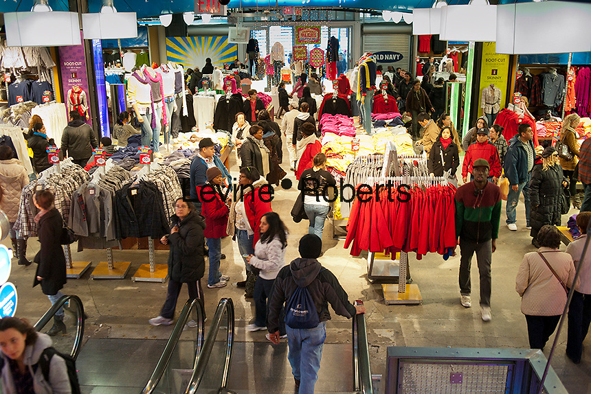 Shoppers in Old Navy in the Herald Square shopping district in New York looking for bargains on Thanksgiving Day, Thursday, November 24, 2011. Many retailers are opening their doors on Thanksgiving or opening up for Black Friday the night before. (© Richard B. Levine)