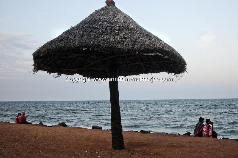 Couples sitting at  Pondicherry beach. Arindam Mukherjee