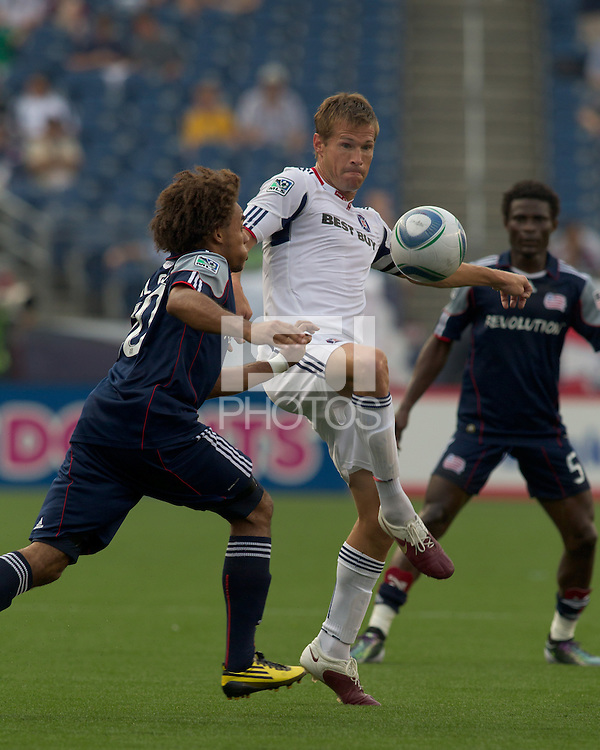 Chicago Fire forward Brian McBride (20) traps the ball as New England Revolution defender Kevin Alston (30) closes. The Chicago Fire defeated the New England Revolution, 1-0, at Gillette Stadium on June 27, 2010.