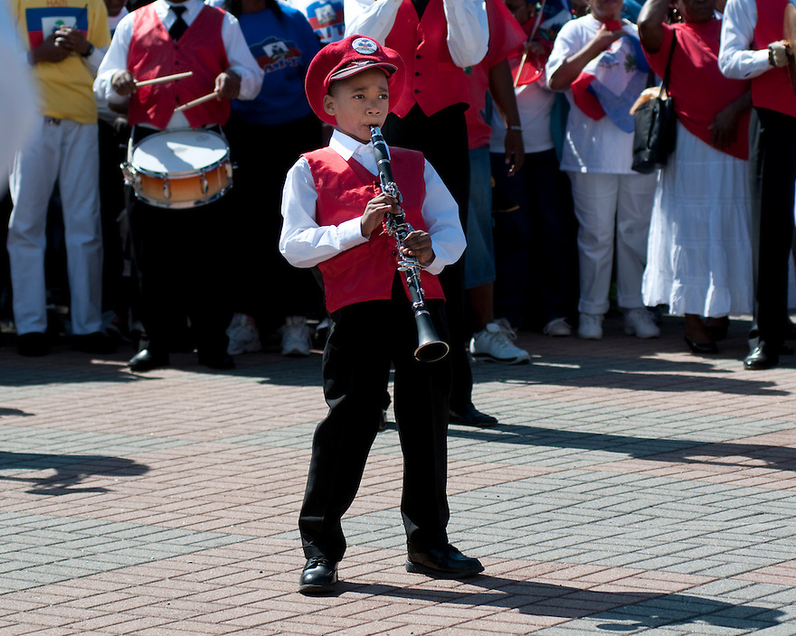BOSTON, MA.-- Samuel Prosper, 7, plays the clarinet witth the Boston Haitian Marching band Sunday after the Haitan American Unity Parade. ..GLOBE PHOTO BY JODI HILTON