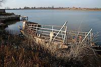 ROMANIA, 7.12.2006, Mila 23, delta of Danube..The Danube delta has been classified in 1991 «Bisophere Reserve» by UNESCO. In Mila 23, on the banks of the old arm Sulina, carcasses of ships will remind Ceausescu indutrialize the delta..ROUMANIE, 7.12.2006, Mila 23, Delta du Danube..Le delta du Danube a été classé en 1991 «Réserve biosphère» par l'UNESCO. A Mila 23, sur les rives de l'ancien bras de Sulina, des carcasses de navires rappellent la volonté de Ceausescu d'industrialiser le delta. .© Bruno Cogez / Est&Ost Photography..