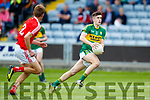 Donal O'Sullivan Kerry in action against Alan Connor Louth in the All Ireland Minor Football Quarter Finals at O'Moore Park, Portlaoise on Saturday.
