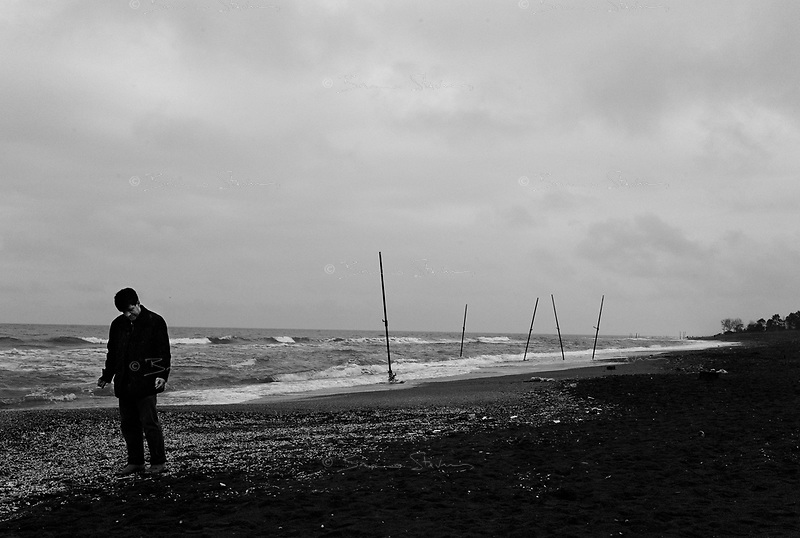 near Mahmoudabad, Iran, March 27, 2007.Only a handful from the thousands Teheranis on holiday in the region show up on the beach on a cold, rainy day...