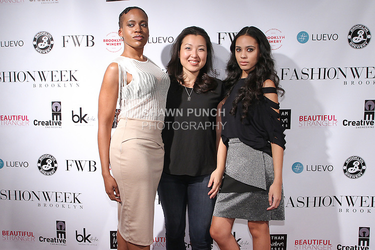 Fashion designer Claire Henkel poses on red-carpet with models, after her Urban Sewn Spring Summer 2015 collection fashion show, during Fashion Week Brooklyn Spring Summer 2015.