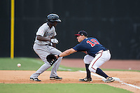 Danville Braves first baseman Ramon Osuna (19) reaches for a pick-off throw as Estevan Florial (55) of the Pulaski Yankees heads back to first base at American Legion Post 325 Field on July 31, 2016 in Danville, Virginia.  The Yankees defeated the Braves 8-3.  (Brian Westerholt/Four Seam Images)
