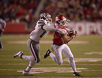 NWA Democrat-Gazette/BEN GOFF @NWABENGOFF<br /> Jared Cornelius, Arkansas wide receiver, attempts to break the tackle of Zach Jackson, Mississippi State defender, in the first quarter on Saturday Nov. 21, 2015 during the game in Razorback Stadium in Fayetteville.
