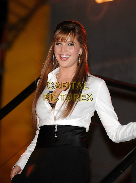 DANIELLE LLOYD.leaving the House during the  the live Celebrity Big Brother Final Evictions, Borehamwood, Hertfordshire, England, January 28th 2007..half length black high waisted skirt white shirt tucked in necklace silver hoop earrings fringe smiling steps.CAP/PL.©Phil Loftus/Capital Pictures