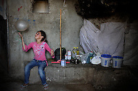"A Palestinian girl plays with a baloon in the cave she  lives in Jenba a Palestinian town of 50 families seats in an area called by the IDF as ""Firing Zone 918"" and is located in the southern Hebron hills near the town of Yatta.  Spread over 30,000 dunams, it includes twelve Palestinian villages.  According to OCHA figures, 1,622 people lived in the area in 2010, and according to local residents the number of inhabitants currently stands at about 1,800. For over a decade, the residents of twelve uniquely traditional Palestinian villages in the area of Masafer-Yatta in the south Hebron hills have lived under the constant threat of demolition, evacuation, and dispossession.The State's insistence on evacuation of Firing Zone 918 in part or in whole, if acceptance by the HCJ, might result in an immediate humanitarian disaster for almost two thousand souls, the destruction of villages, and the eradication of a remarkable way of life that has endured for centuries."
