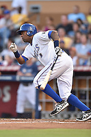 Durham Bulls designated hitter Wilson Betemit #14 swings at a pitch during a game against the Toledo Mud Hens at Durham Bulls Athletic Park on July 25, 2014 in Durham, North Carolina. The Mud Hens defeated the Bulls 5-3. (Tony Farlow/Four Seam Images)