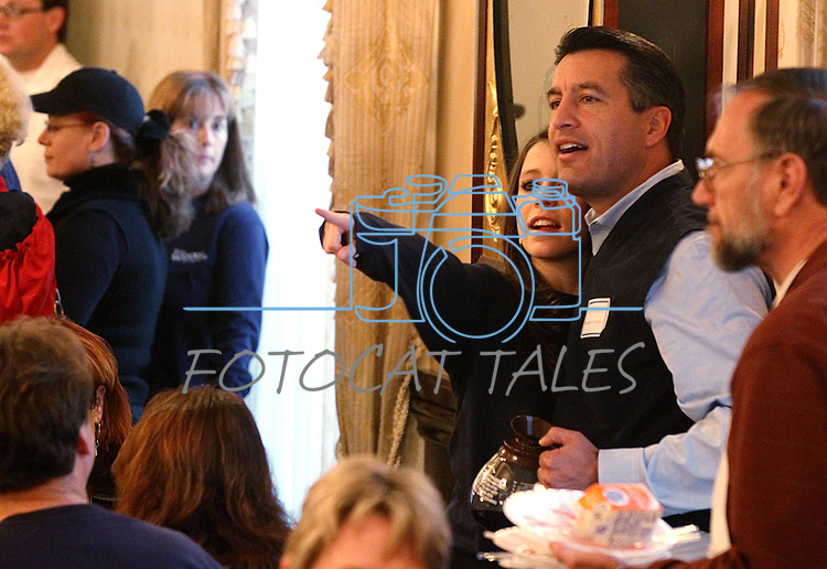 Gubernatorial candidate Brian Sandoval and his daughter Maddy, 13, look across the crowd during the annual Carson City Republican Women's Nevada Day Pancake Breakfast at the Governor's Mansion on Saturday morning, Oct. 30, 2010, in Carson City, Nev. .Photo by Cathleen Allison