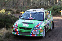 Bruce McCombie - Michael Coutts in a Mitsubishi Evolution competing at Junction 6 on the Munro Scotch Beef Millbuie Special Stage 1 on the 2014 Arnold Clark/Thistle Hotel Snowman Rally, supported by Highland Office Equipment, part of Capital Document Solutions which was organised by Highland Car Club and based in Inverness on 22.2.14; Round 1 of the 2014 RAC MSA Scottish Rally Championship sponsored by ARR Craib Transport Limited.
