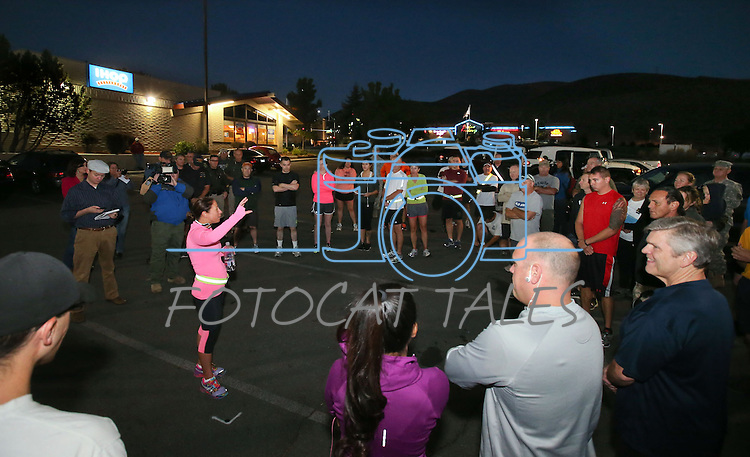 Event organizer Laura Boldry, center, talks to participants before an early morning memorial 5K walk and run in honor of the victims of the 2011 IHOP shooting in Carson City, Nev., on Friday, Sept. 6, 2013.  <br /> Photo by Cathleen Allison