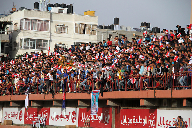 Palestinian fans attend the final football match of the Palestine Cup for the southern governorates between Shabab Khan Younis football club and Shabab Rafah football club at Palestine stadium in Gaza city on April 30, 2018. Photo by Mahmoud Ajour