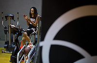 Jun. 10, 2013; Phoenix, AZ, USA: Phoenix Mercury center Brittney Griner cheers on teammates as she rides an exercise bike during a team practice at the US Airways Center. Mandatory Credit: Mark J. Rebilas-