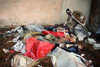 Bodies of men found in a mass grave lie covered in sheets and plastic in the grounds of a school in the eastern Damascus suburb of Sakba. Locals say they were unable to bury the dead killed during an assault by government forces in an attempt to take the area back from the Free Syrian Army. Protests against the ruling Baathist regime of Bashar al-Assad erupted in March 2011. Although they were initially peaceful,  they were violently repressed by the Syrian army and police. In response to being ordered to shoot unarmed civilians, large numbers of men deserted the army and formed the Free Syrian Army. The protest movement has now turned into an armed uprising with clashes between the regular army and the Free Syrian Army taking place in early 2012....
