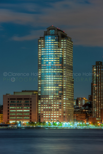 The skyscraper at 388 Greenwich Street in New York City (originally called the Shearson Lehman Plaza) illuminated during evening twilight as viewed over the Hudson River from Jersey City, New Jersey