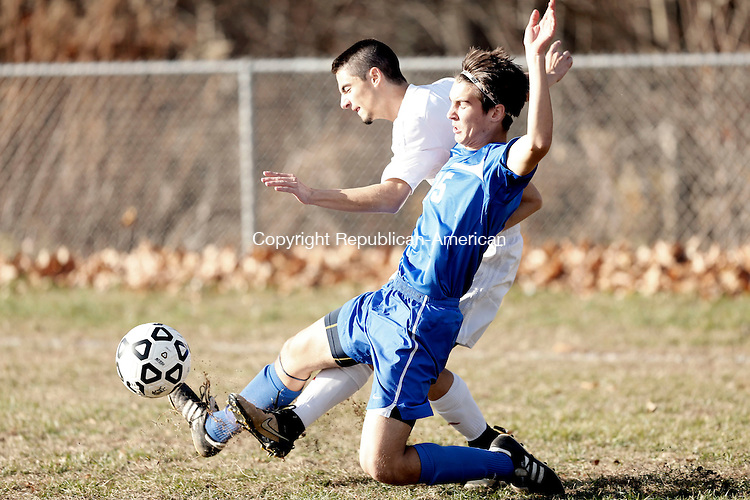Litchfield, CT- 10 November 2016-111016CM03- Wamogo's Colby Weik back, and St Paul's Vincent Penisse slide in for the ball during their state tournament matchup on Thursday.     Christopher Massa Republican-American