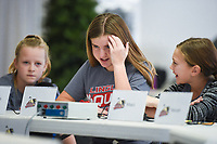 NWA Democrat-Gazette/CHARLIE KAIJO Greer Lingle Middle School students Jaidyn Sampier (from left), Sydney Gaffney and Maci Hamby think about the answer to a quiz question, Monday, December 2, 2019 during the middle school Quiz Bowl at the Center for Non-profits in Rogers.<br /> <br /> Students from all four Rogers middle schools and two teams from Rogers elementary schools, Frank Tillery Elementary and Mathias Elementary, participated in the statewide middle school level Quiz Bowl. Teams of five students test their knowledge and quick recall using a buzzer.