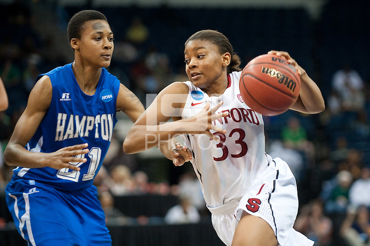 NORFOLK, VA--Amber Orrange drives hard against Hampton University at the Ted Constant Convocation Center at Old Dominion University in Norfolk, VA in the first round of the 2012 NCAA Championships. The Cardinal advanced with a 73-51 win to play West Virginia on Monday, March 19.