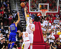 Seth Curry of the Blue Devils converts a layup over Alex Len of the Terrapins. Maryland defeated Duke 81-83 at the Comcast Center in College Park, MD on Saturday, February 16, 2013. Alan P. Santos/DC Sports Box