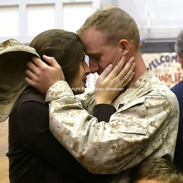 HARTFORD, CT; 25 OCTOBER 2006; 102506BZ17- Valerie Stolfi, of Waterbury, hugs her fiance  Cpl. Randy Collins, of West Hartford, during a returning troop ceremony at the State Armory Wednesday night.<br /> Troops from Company C, 1st Battalion 25th Marines returned to the State Armory in Hartford Wednesday night after serving for seven months in Fallujah, Iraq.  <br />  Jamison C. Bazinet Republican-American