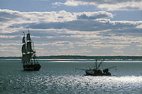 USA, Newport, RI - A fishing boat and a tallship both head out to sea on the east passage of the Narrangasett bay. The tallship is the HMS Rose, a replica of a revolutionary war British ship.