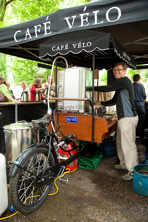 The extremely popular Saturday Portland Farmers' Market, located in the South Park Blocks near the Portland State University Campus, offers a large selection of locally grown organic produce, fish, meat and foodstuffs.  Pictured here is Cafe Velo, a bicycle powered coffee stand.  Owner Rick Wilson is at the helm.  www.cafe-velo.com