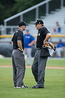 (L-R) Umpires Mark Stewart and Grant Hinson discuss a call during the Appalachian League game between the Bluefield Blue Jays and the Burlington Royals at Burlington Athletic Stadium on June 27, 2016 in Burlington, North Carolina.  The Royals defeated the Blue Jays 9-4.  (Brian Westerholt/Four Seam Images)