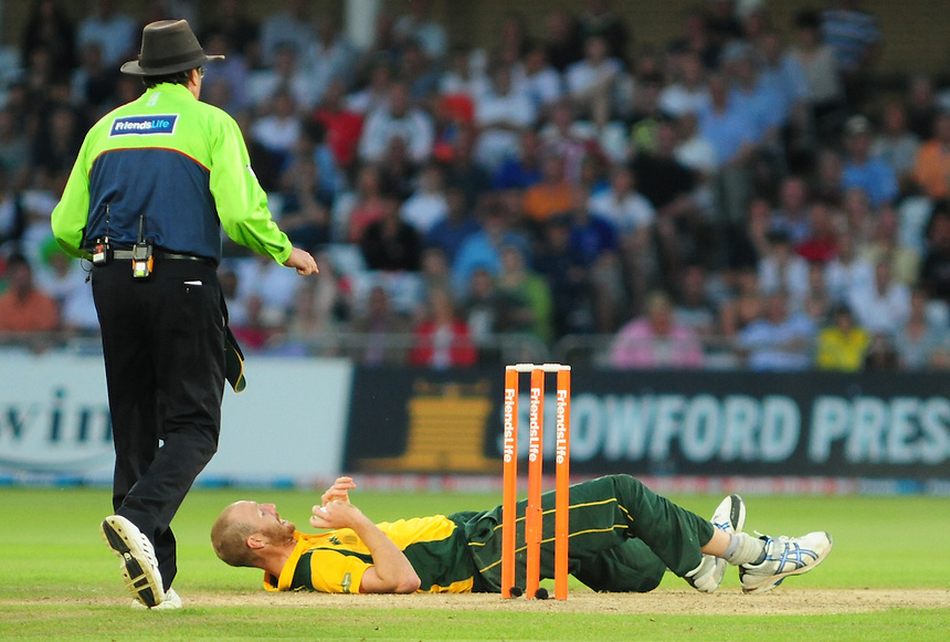 Nottinghamshire Outlaws' Andrew Carter slips as he runs up to bowl at Hampshire Royals' Neil McKenzie ..County Cricket - 2012 Friends Life t20 Quarter Final - Nottinghamshire Outlaws vs Hampshire Royals - Wednesday 25th July 2012 - Trent Bridge - Nottingham..