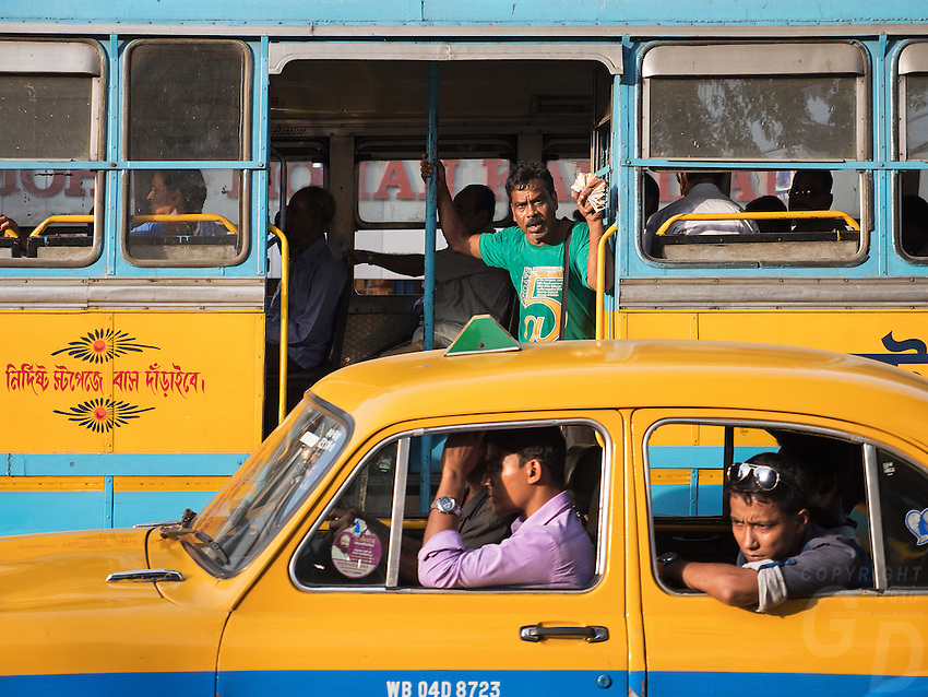 Kolkata transport, Yellow Cab and Busses in traffic, West Bengal, India