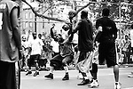 "May 4th 2010. New York, New York. United States..Located in the heart of Greenwich Village, the West 4th Street basketball Court, known as ""The Cage"", offers no seating but attracts the best players and a lot of spectators as soon as spring is around the corner..Half the size of a regular basketball court, it creates a fast, high level of play. The more people watch, the more intense the games get. « The Cage » is a free show. Amazing actions, insults and fights sometimes, create tensions among and inside the teams. The strongest impose their rules. Charisma is present..""The Cage"" is a microcosm. It's a meeting point for the African American street culture of New York. Often originally from Jamaica or other islands of the Caribbean, they hang out, talk, joke, laugh, comment the game, smoke… Whether they play or not, they're here, inside ""The Cage"". Everybody knows everybody, they all greet each other, they shake hands and hug: ""Yo, whasup man?"""