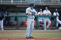 Nate Soria (5) of the Xavier Musketeers tightens his glove prior to his at bat against the Penn State Nittany Lions at Coleman Field at the USA Baseball National Training Center on February 25, 2017 in Cary, North Carolina. The Musketeers defeated the Nittany Lions 10-4 in game one of a double header. (Brian Westerholt/Four Seam Images)
